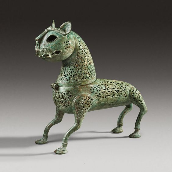 Islamic bronze incense burner in the shape of a feline, 11th century A.D. 27 cm high. Private colelction