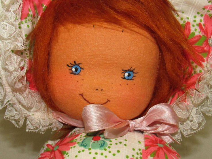 "This doll has a great look.  It is in good condition with a few blemishes.  Her hair is excellent.  Her dress has some light soil on her chest area.  The sash does have some stains.  Her shoes are great.  Her pantaloons have two spots of light soil.  Her face is beautiful.  Her arms and hands have three small ""holes"", spots where the felt has deteriorated as old felt does.  Her size is hard to describe, she sits around 12"" across and 12"" tall.  There are no poor smells an..."