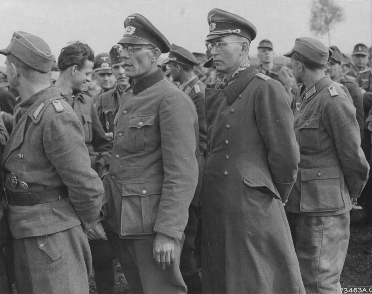 German POW officers line up after the surrender (May 1945). Most German officers of lower to medium rank were allowed to go home after a short period of processing. Anyone from the rank of colonel and above, however, was within the jurisdiction of Allied military intelligence and senior Allied commanders. Officers of General rank experienced significantly lengthier periods of processing and interrogation.