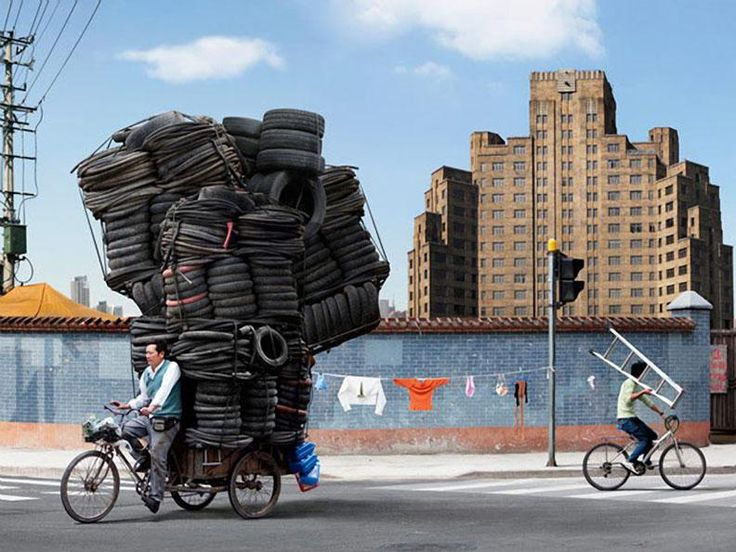 Manufactured Totems (Deliveryman in China has his bicycle fully loaded with tires)