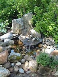 backyard rock fountain, would love to do this! (rather then a decorative pond that I would worry about the kids falling into all the time)
