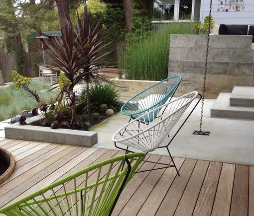 Mix it Up! - Keep it interesting by mixing surfaces - cedar decking panels with concrete
