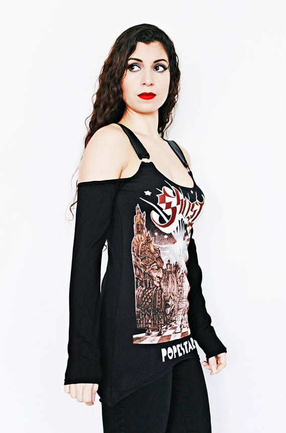 Ghost bc Shirt - Popestar - Fitted and figure flattering. - Faux matte leather shoulder straps. - D-rings. - Pointed hem. - Open Shoulder Long sleeves. - Super soft black jersey fabric. Would look killer over a pair of pleather leggings. Im sure you have a pair in your closet that