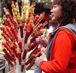Tanghulu - traditional Chinese snack of candied fruit. consists of fruits such as oranges, strawberries on bamboo skewers. This snack can be found widely along the Beijing snack street Wangfujing & street vendors who travel from place to place selling it. Tanghulu has a hardened sugar coating but there are chocolate, sesame versions as well.