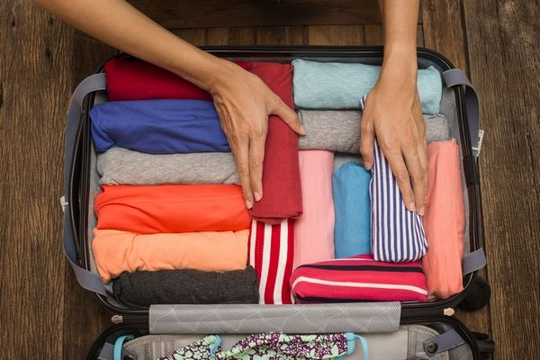 Packing Suitcase Rolling Clothes To Save Space In Suitcase Pack Suitcase Luggage Wrinkle Free Trave Packing Tips For Travel Packing Clothes Packing Tips