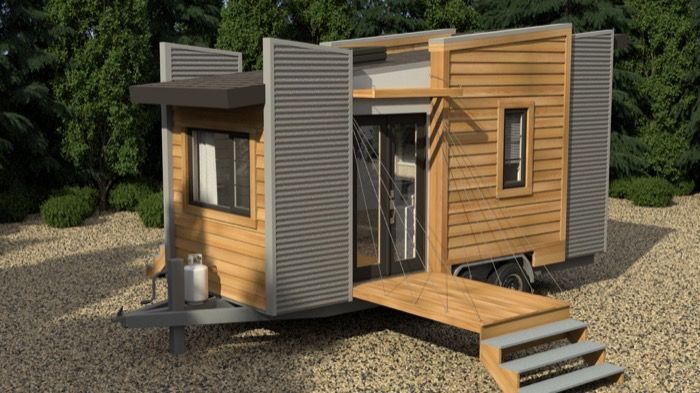 This is the Robinson DragonFly Tiny House design byRobinsonPlans.com. It's design to be built on a trailer and features a fold down porch for when you're parked on site. Inside you&#82…