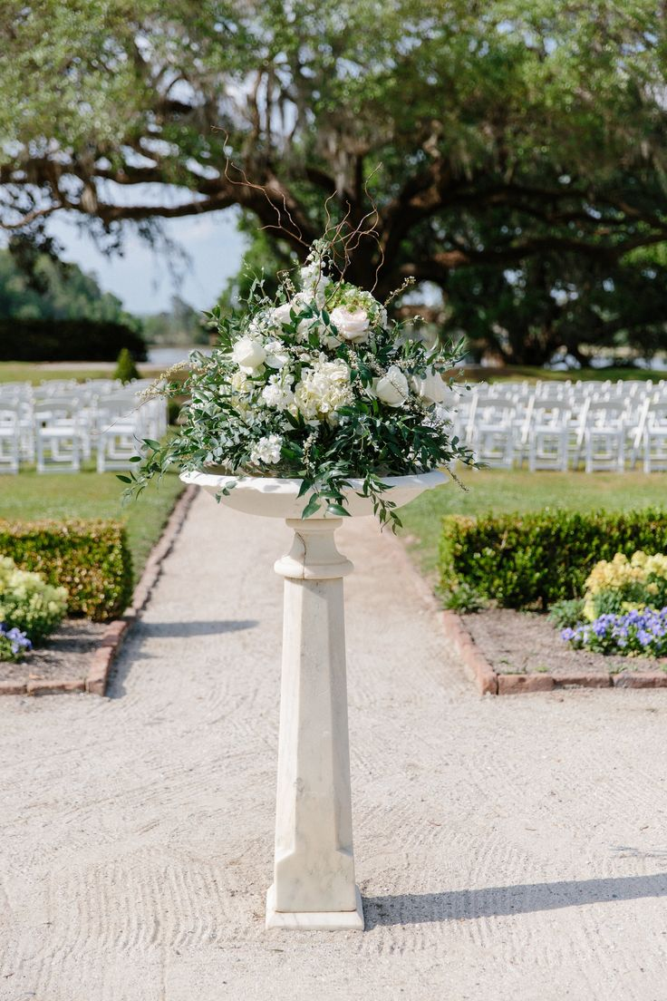 A beautiful wedding at Middleton Place. Designed by Ooh! Events, photographed by Sara Petras