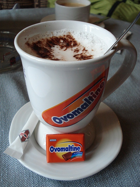 "The chocolate drink Ovomaltine (known in the USA as ""Ovaltine"") originates in Switzerland and enjoys ongoing popularity, particularly with young people. Aside from being a beverage, the powder is also eaten sprinkled on top of a slice of buttered bread."