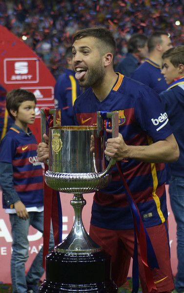 """Barcelona's defender Jordi Alba holds the cup as he celebrates after winning the Spanish """"Copa del Rey"""" (King's Cup) final match FC…"""