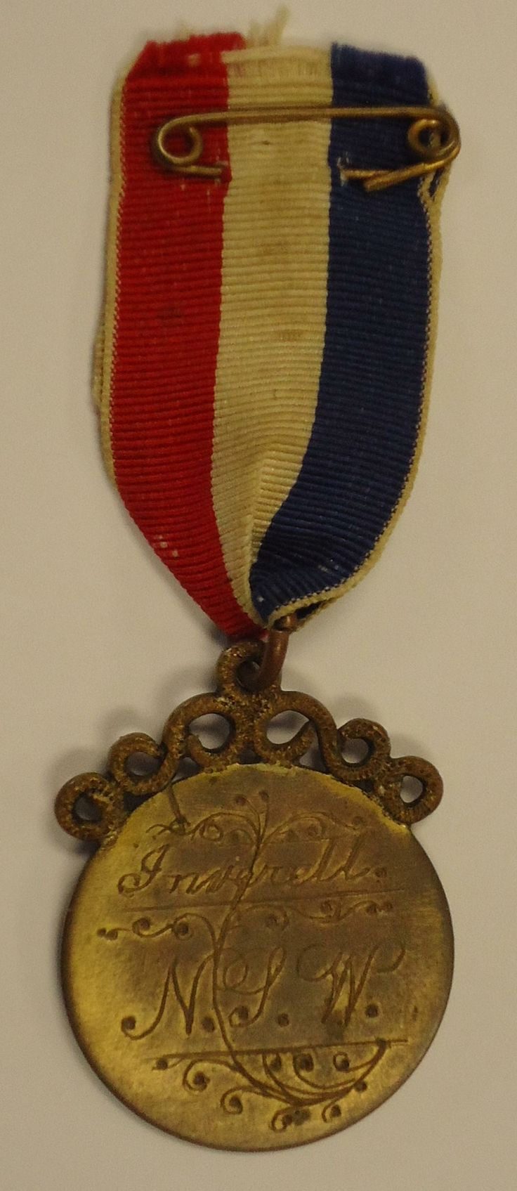 The Inverell Medal, given to volunteers when they left the district to serve during the First World War. The volunteer's name is engraved on one side, with date of departure.   The reverse is engraved with the words Inverell NSW