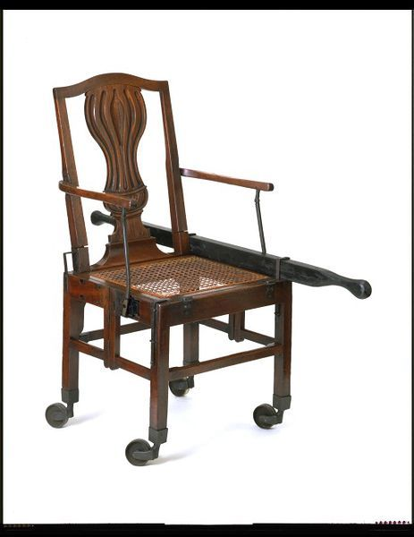 Folding chair, 1780, Mahogany, with cane seat and iron fittings. Given by Mr and Mrs H. R. Marshall. l Victoria and Albert Museum