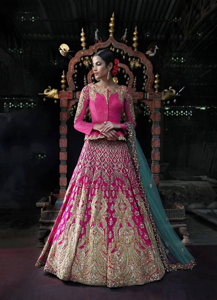 Gorgeous pink and gold designer bridal lehenga. Indian bridal fashion.