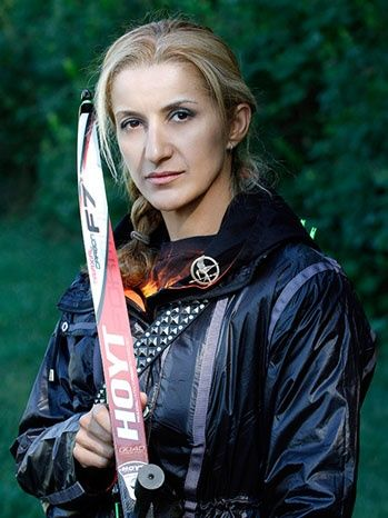 Khatuna Lorig - olympic archer who trained Jennifer Lawrence, cosplayed as Katniss during the games! Wicked cool.