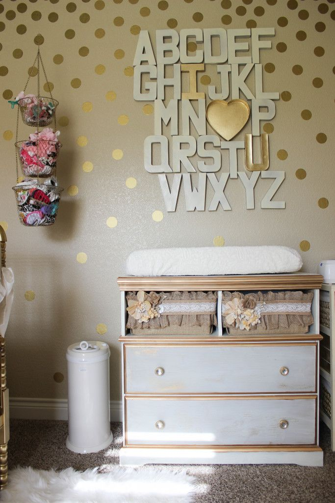 a gorgeous girly gold nursery loving the diy wall art above this changing table