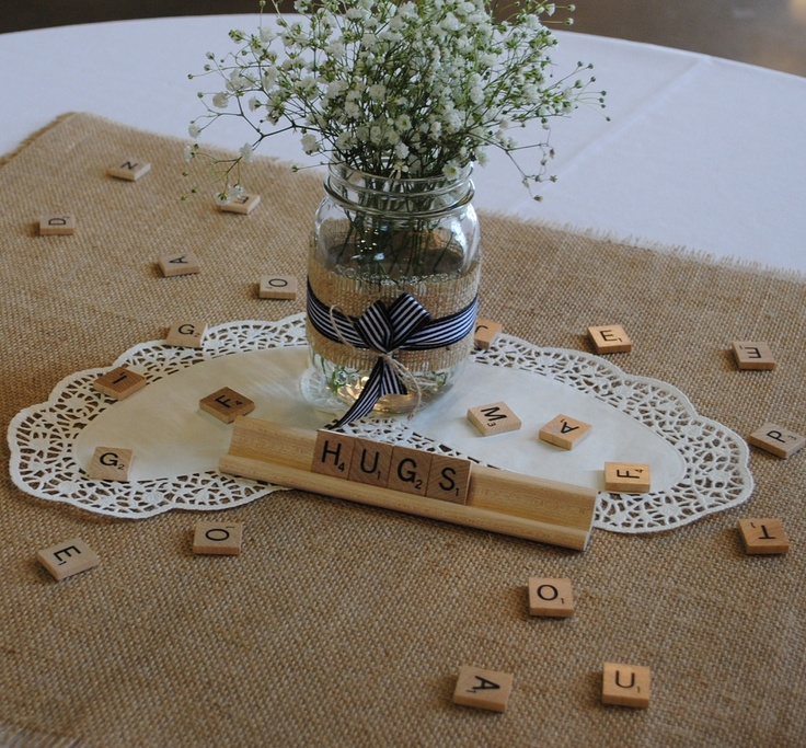 Mason Jar Centerpieces. Rustic-Chic Bridal Shower for our friend Rhonda. ABC themed shower. Guest brought gifts starting with the initials of their first or last name and the bride had to guess who gave the gift.  We decorated black and white with burlap and used letters and scrabble pieces for the ABC theme.
