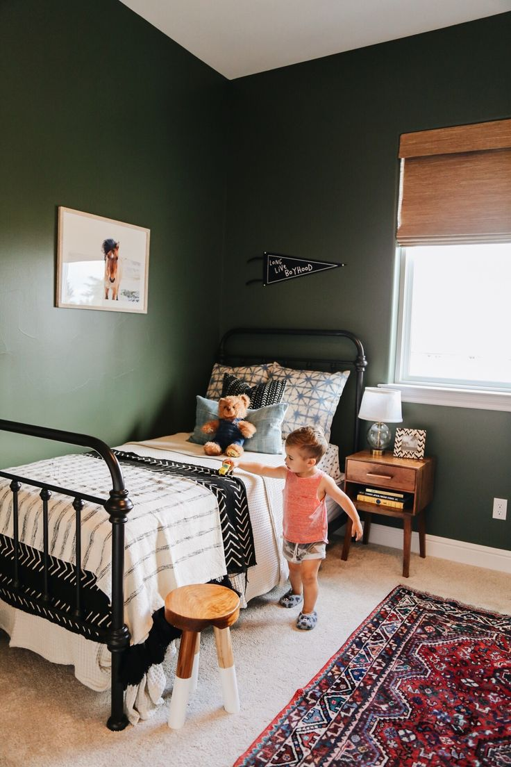 Toddler room, iron bed, dark green walls, big boy room, boy nursery, @kailawalls,