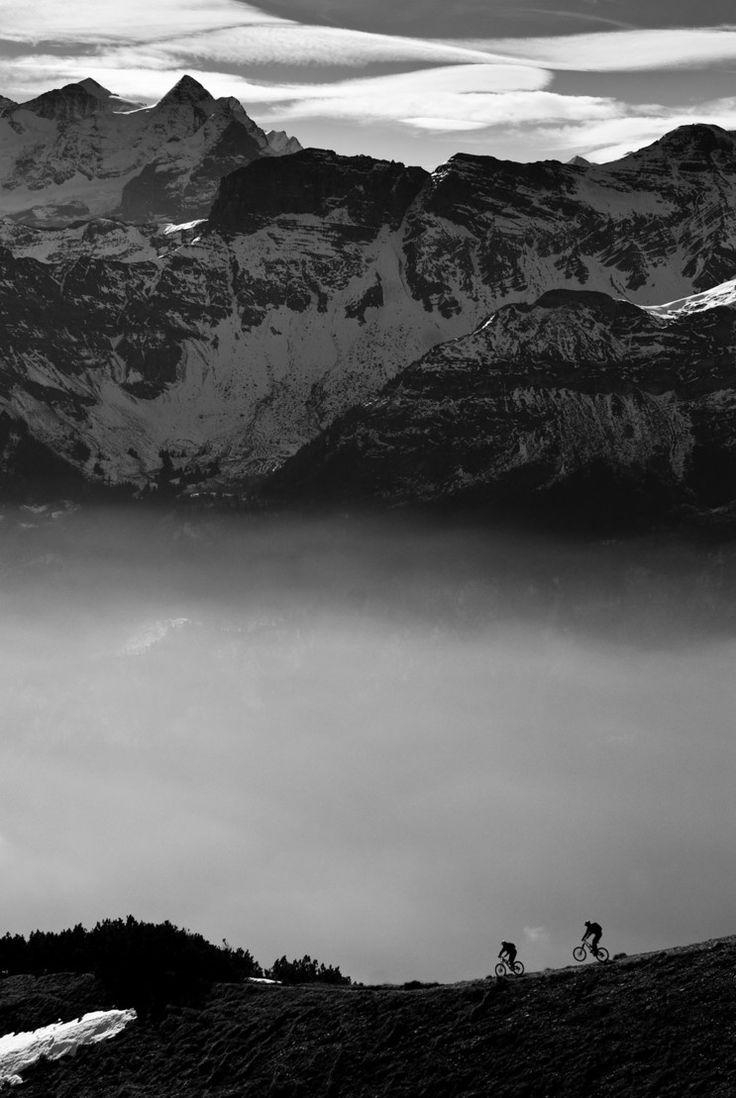 Freeride Mountain Biking in the Swiss Alps. Photo by Roger Gruetter