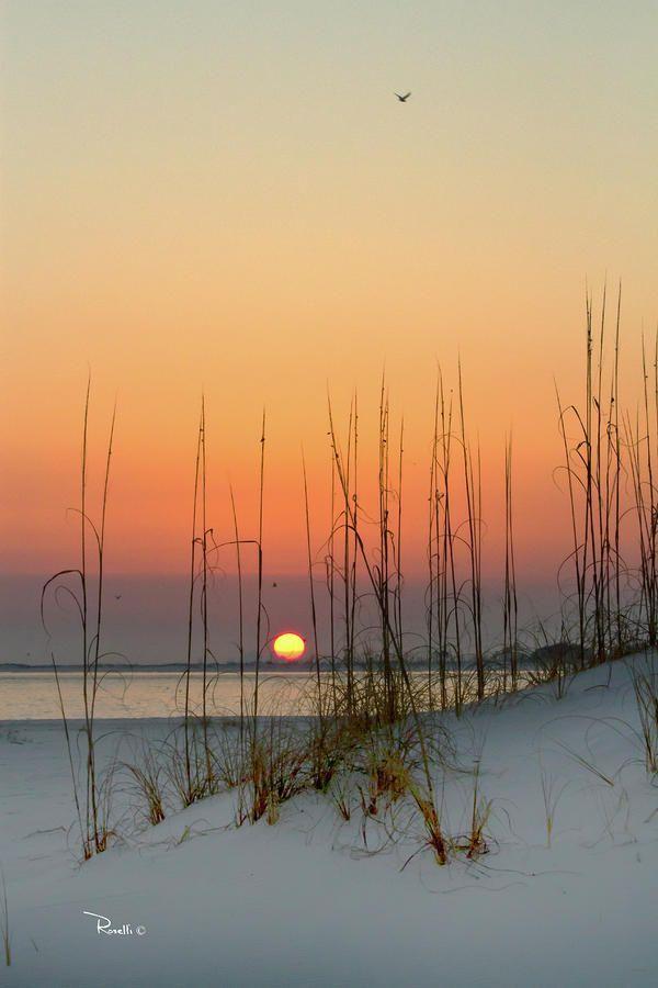 Puesta de sol. Nieve y playa