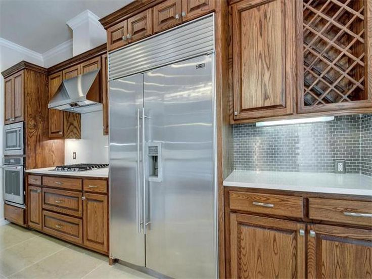 Gourmet Kitchen With Wood Cabinetry And Stainless Steel Appliances Midwood  Pkwy, Austin, TX 78736