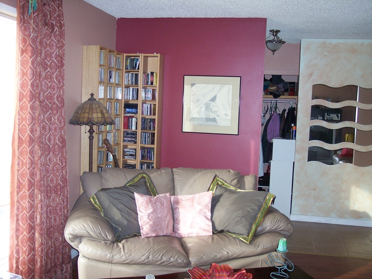 The living room after reno.  Laminate laid by Ivo of Julia's Alpine Gardens. Pillows, drapes, paint and mirrors done by me, Dorothy.