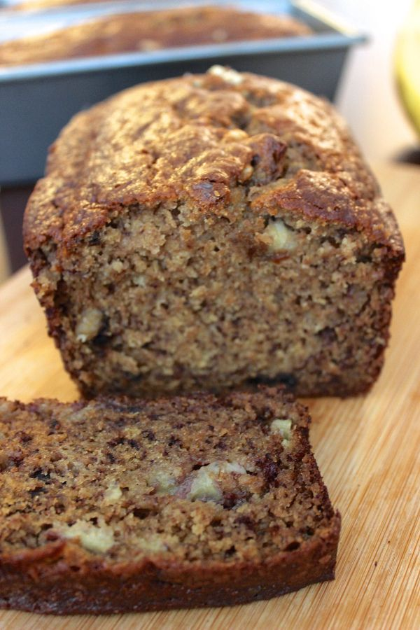 New favorite healthy banana bread recipe with less than 200 calories per slice! So easy to make, plus it's moist and delicious.