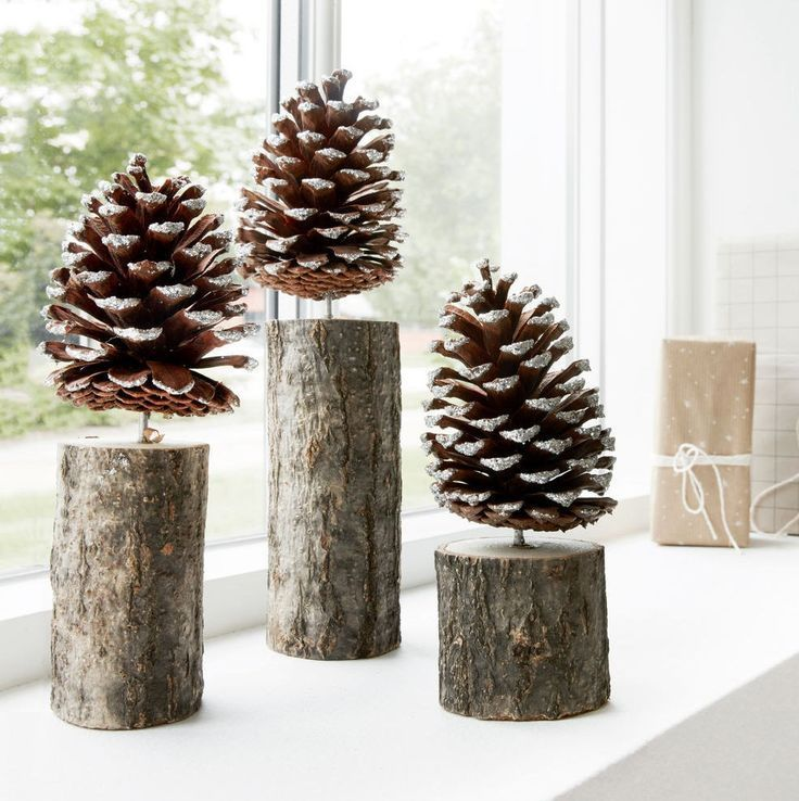 Nordic inspired Pinecone Trees with a light dusting of sparkly snow. Use one or group several together as part of your festive Christmas decorations.