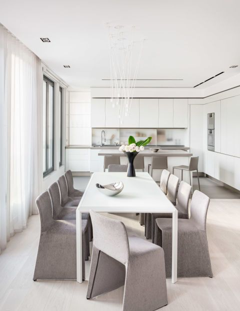 All white dining room and table with a soft touch of grey designed by KNOF Design.