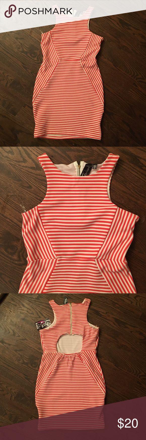 Striped mini dress by Trixxi size 9 Trixxi mini dress with cutout back. Size 9. Gold zipper in back. Trixxi Dresses Mini