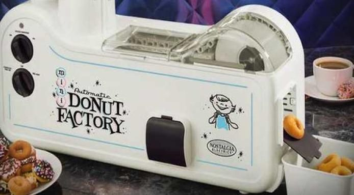 Donut Factory: This handy gadget produces, mini #donuts in just 90 seconds! http://www.finedininglovers.com/blog/curious-bites/mini-donut-factory/