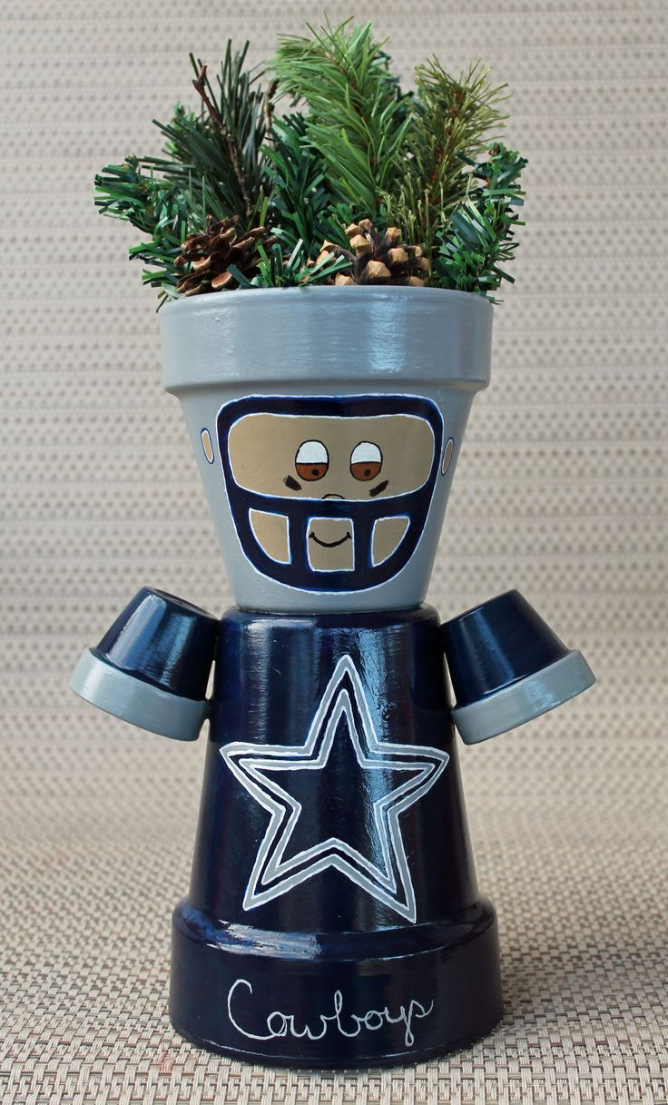 Dallas Cowboys - clay pot craft -terracotta pot - football player - made with acrylic paint, garland and pinecones. Image only.