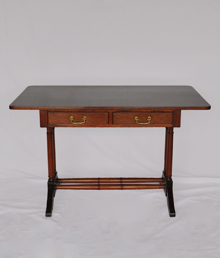 SOLD! #NorthcliffAntiques A reproduction Georgian mahogany sofa table, the rectangular top above two frieze drawers supported by turned legs joined by two turned stretchers, with French polish finish. The sofa table emerged in the 1800's from its smaller progenitor, the Pembroke table as a lady's station for writing and drawing. The style of handles are also usual of the Georgian period. #Antiqueshops #Johannesburg #Classic #Antiques
