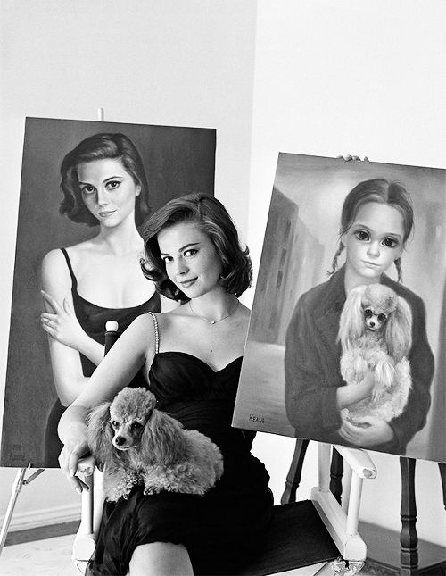 nataliewood-: Natalie Wood posing with her portraits by artist Margaret Keane, 1960