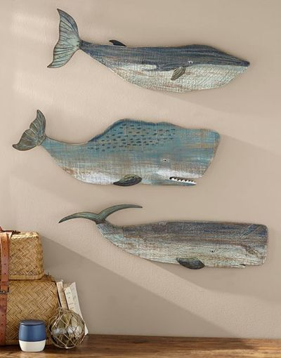 This handmade sea-inspired Painted Wood Whales Wall Art is meant to be displayed year-round. Natural imperfections in the wood make each one of a kind. Set of 3. $179 Sale $152. Buy here.