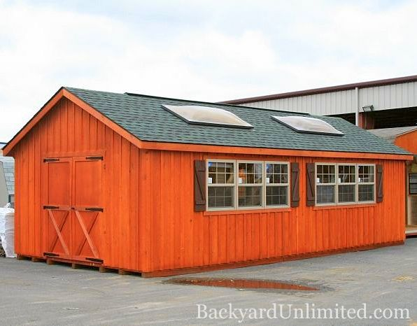 14'x32' Garden Shed with Pine Board and Batten Siding, Ridge Vent, Skylights, , Rustic Cedar Stain, Shutters and Additional Vinyl Windows http://www.backyardunlimited.com/sheds/garden-sheds
