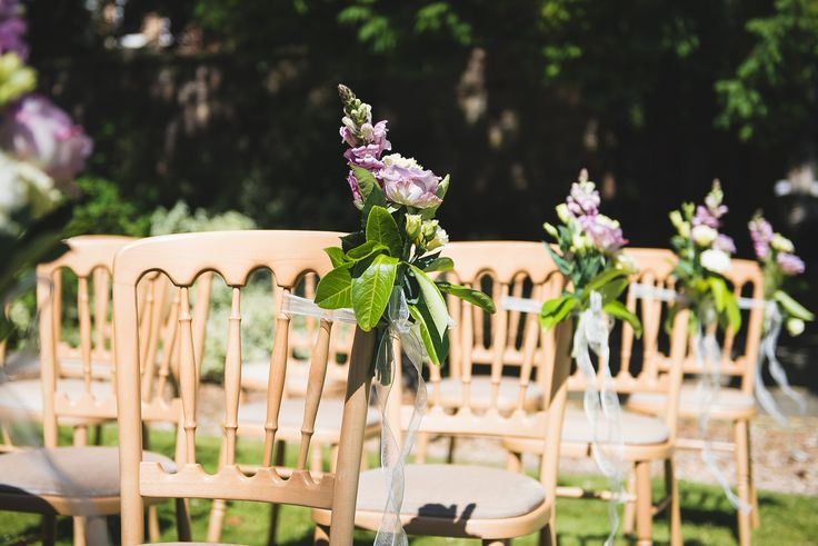 Garden wedding ceremony at The Mansion House, Bristol #chair #flowers| Flowers by http://www.emmadesignerflorist.co.uk/ | Image credit http://www.lifeinfocusphotography.co.uk/