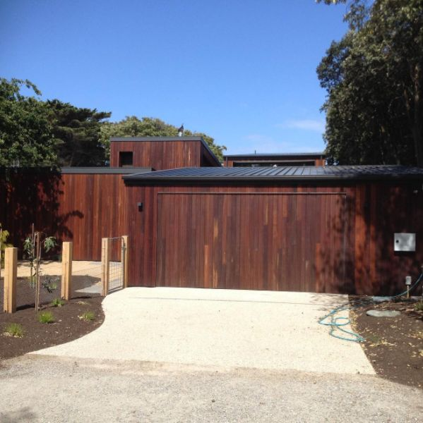 Ironbark shiplap cladding freshly installed and oiled. Natural colouring.
