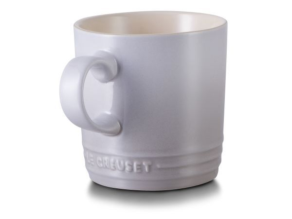 Le Creuset Stoneware Mug, 350ml - Mugs see us through all kinds of situations - from sunrise coffee dates to frothy hot chocolate on autumn nights and afternoon tea chats, they are trusty companions as we go about our day. These moments are that bit sweeter when your mugs are good quality and good looking, like these stoneware gems from Le Creuset.