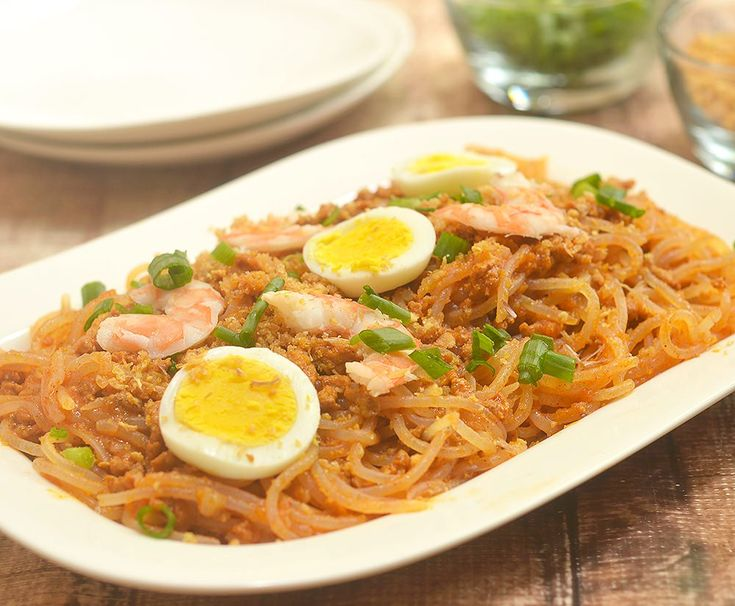 Pancit Luglug Recipe made easy with ground pork gravy and simple toppings. Hearty and delicious, it's a classic Filipino comfort food!