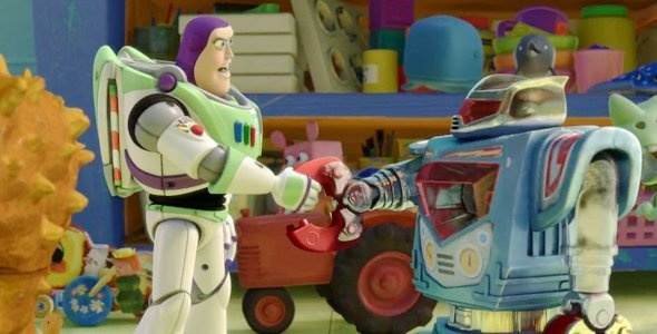 34 seconds into the second Toy Story 3 trailer Buzz shakes hands with a robot toy and behind them a tractor drives past. This tractor looks like one of the vehicles in Cars where Mcqueen and Mater go tractor tipping