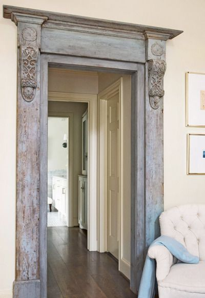 Salvaged door mouldings used to add architectural interest in the home + before and after pics of a home remodel. Great post that shows how a dated home is updated.