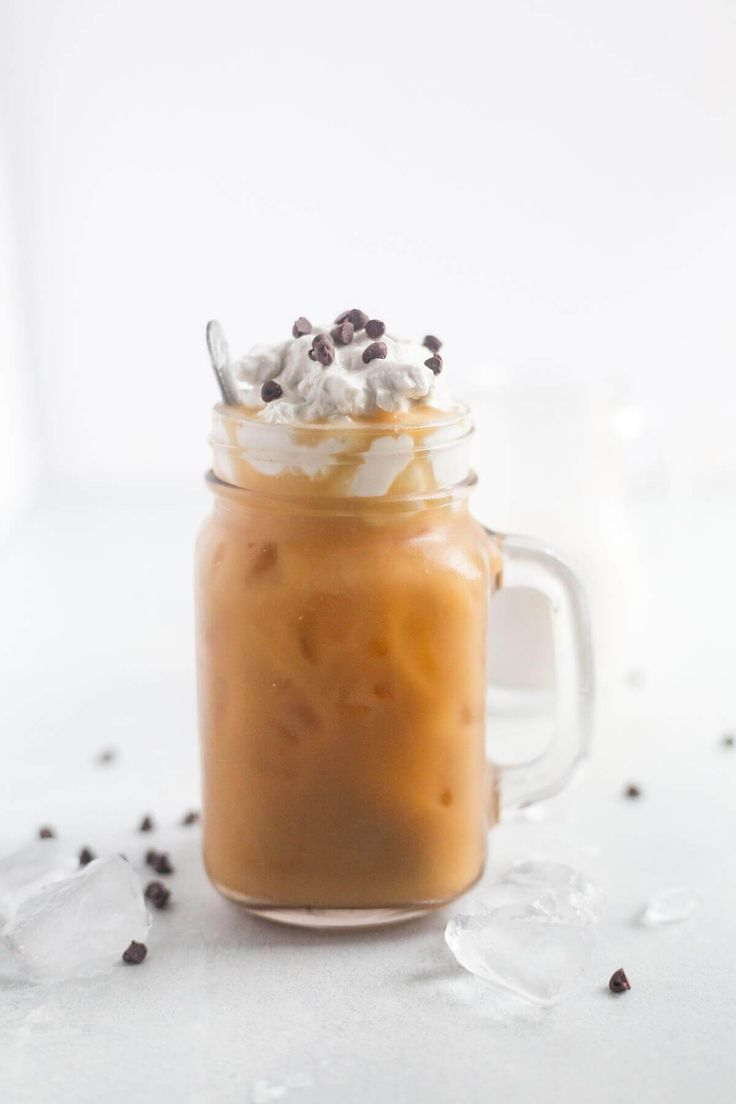 Mocha Coconut Iced Coffee is cool, refreshing and packed with coconut and chocolate flavor. It's made with with Dunkin' Donuts Coconut Ground Coffee, coconut extract coconut milk and cocoa powder. Top it with coconut whipped cream and chocolate chips!
