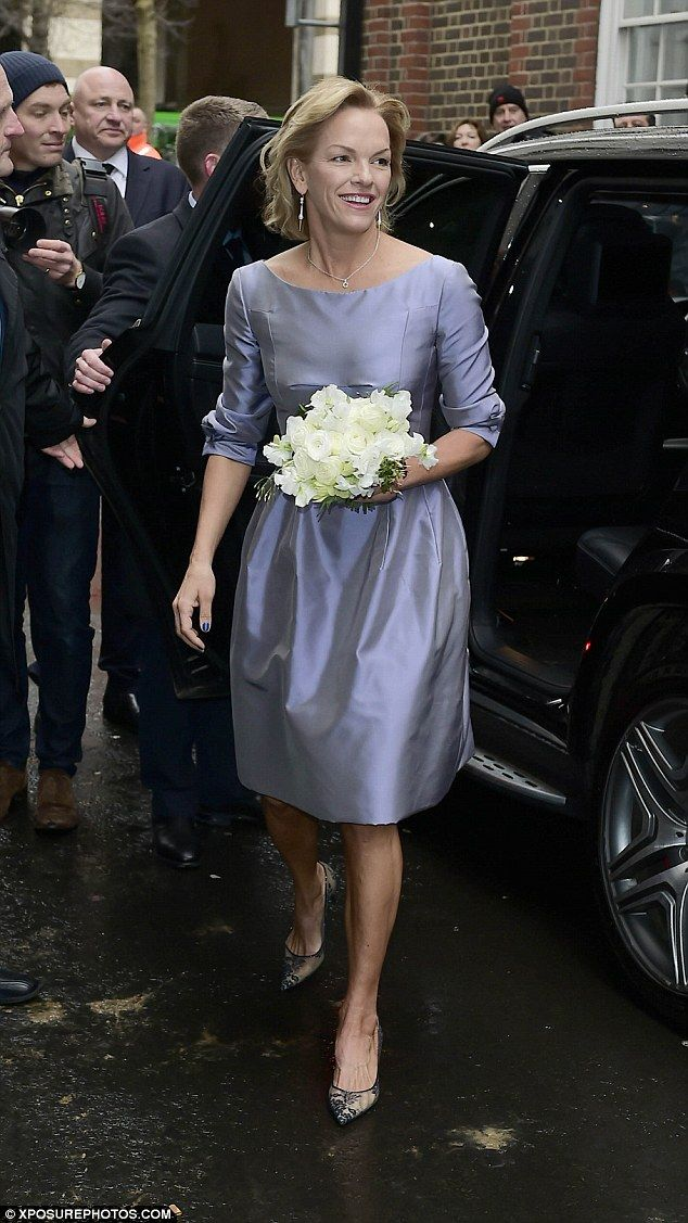 Family day: Elisabeth Murdoch looked elegant in satin knee-length bridesmaids...