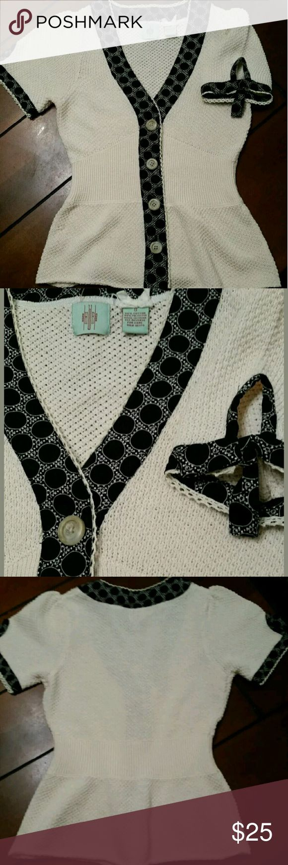 Anthropologie HWR cream short sleeve cardigan S Tie and peep holes on sleeves. Design on trim is black,white and grey.One small snag on bottom front. Buttons intact. Good preowned condition anthropologie  Tops Button Down Shirts