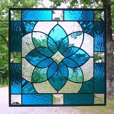 Aqua blue geometric stained glass panel by livingglassart home of oddballs and oddities, via Flickr
