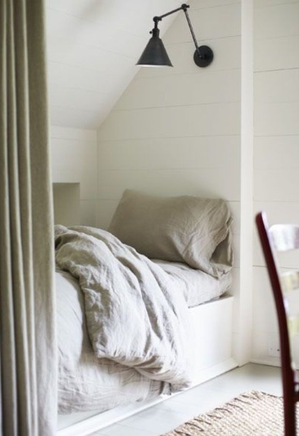 But not below roofline. Instead, create split wall shelving, where the other side has sliding door access to bedside shelf.