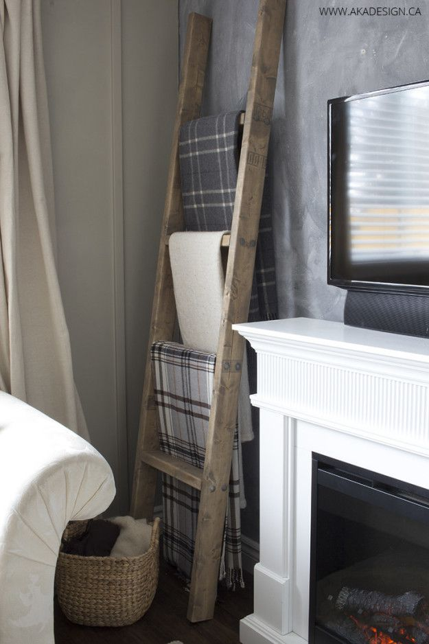 Make a ladder display for your favorite throws and blankets (for less than $25, too). | 27 Clever Projects Anyone Can Make With 2x4s