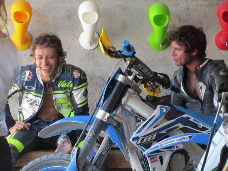 Valentino Rossi and Guy Martin sharing a laugh after a motard session