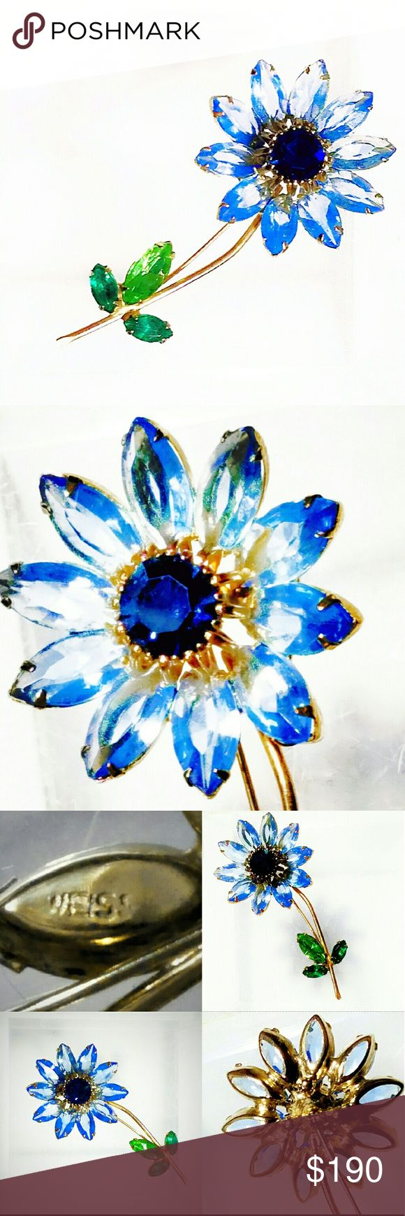 """Weiss Flower Pin Made by DeLizza and Elster- RARE! Vintage Weiss Flower Pin made by DeLizza and Elster (D&E) of Juliana fame. This is a cateloged Book Piece, shown in Judith Miller's book, """"Costume Jewelry"""" (2003) on page 132. There are very few Weiss pieces confirmed to have been made by D&E, making this brooch very rare & highly collectible. The dazzling prong-set navettes of blue Austrian crystal rhinestone petals & leaves w/a faceted sapphire blue crystal center are set in gold-plated…"""