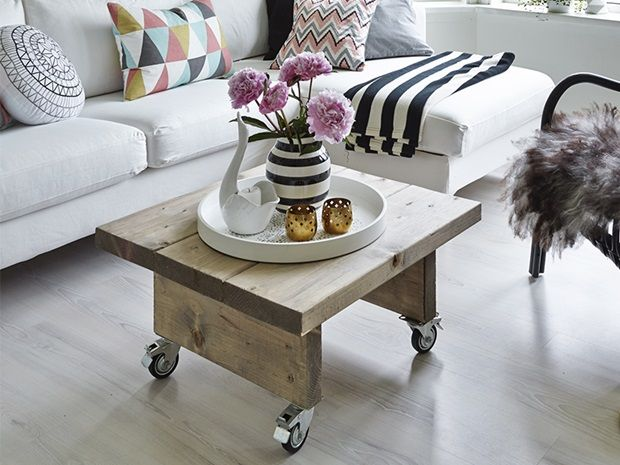 Contemporary sofa, modern pattern on the pillows, DIY simple wood coffee table with casters.