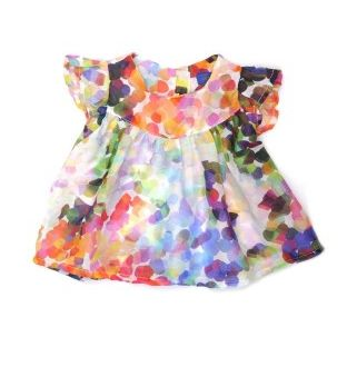 soooo cute: polka dot dress from Simple Kids. Way too expensive for kids clothes though.